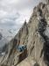 Luftige vorletzte Seillänge - Querung über abschüssige Blöcke zum Start der Gipfelplatte